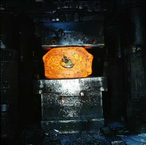 The temperature is depending on the forging blank (steel, iron, alloys) and process between 950 °C and 1250 °C.