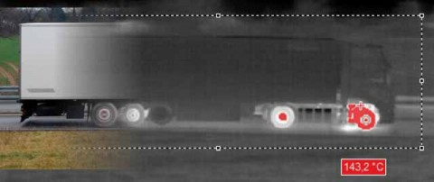 Overlap of the visual image and the thermal image of a truck. The ir camera measures a tire temperature of 143.2 °C.